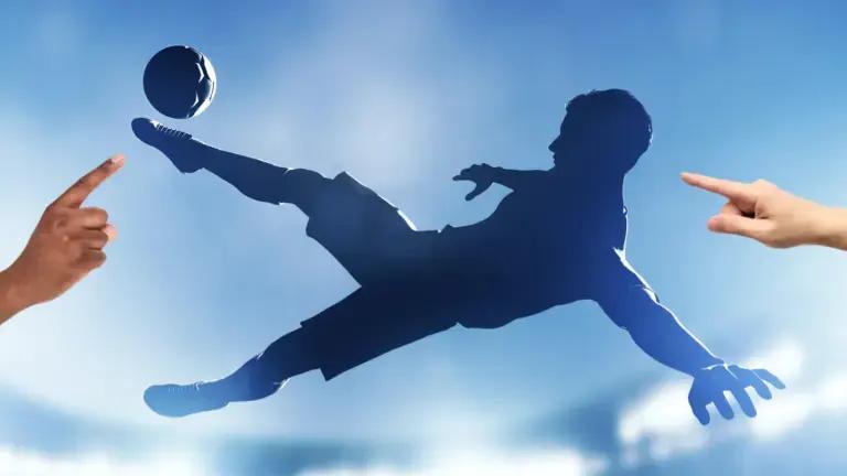 A silhouette of a footballer