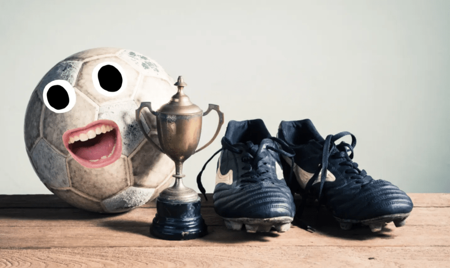 A football trophy and boots