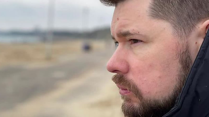 Famous YouTuber gazes out to sea wondering about something