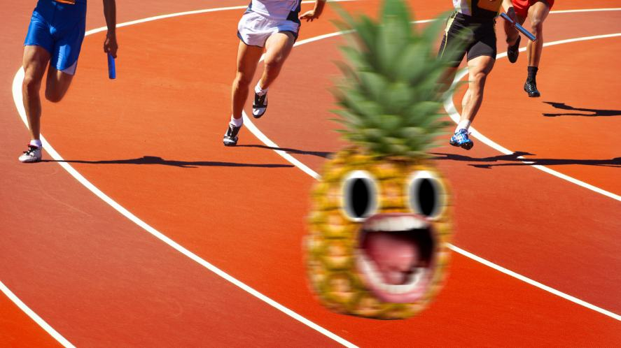 A pineapple being chased by several athletes