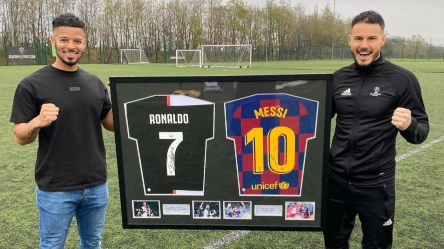 The F2 Freestylers with signed Ronaldo and Messi shirts