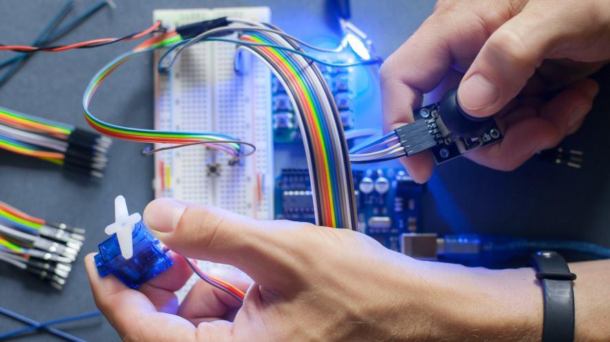 An inventor fixes a computer part