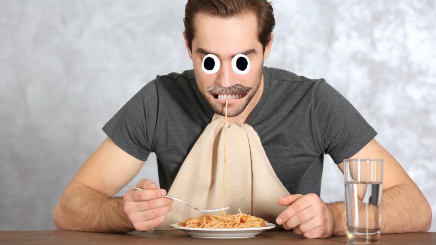 A man eating spaghetti bolognese
