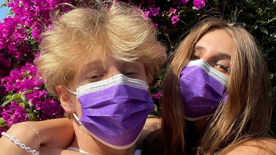 Lev and his girlfriend wearing masks