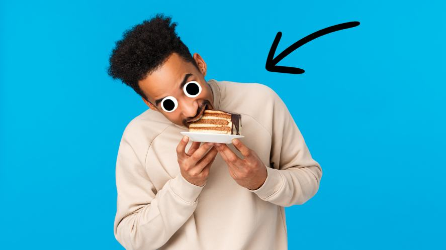 A man takes a bite of cake