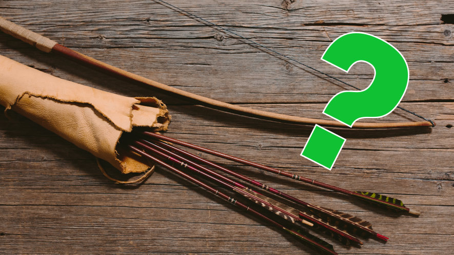 Bow and arrows on wooden background with green question mark