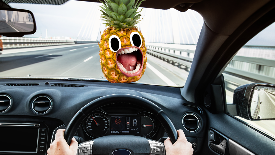 Someone driving with screaming pineapple
