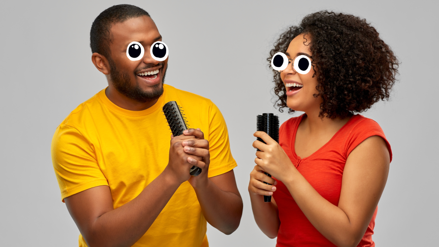 Man and woman singing into hairbrushes