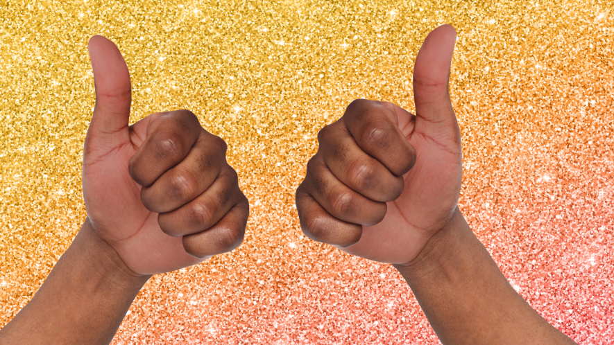 Two thumbs up on glittery background