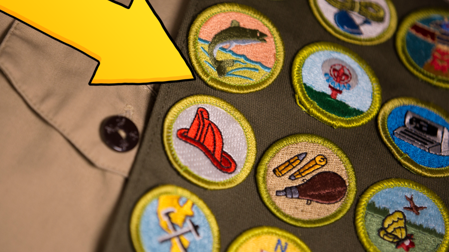 Yellow arrow pointing to Scout badges