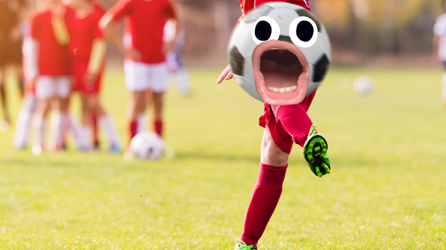 Boy kicking football with face