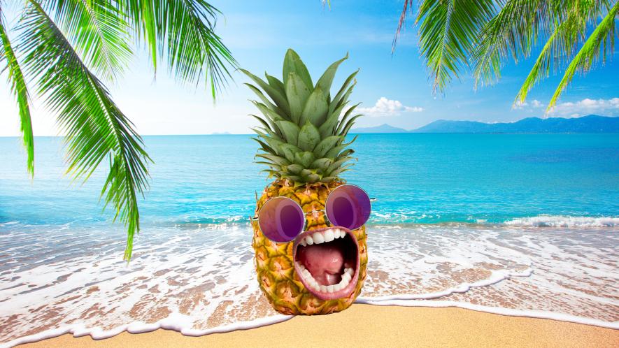 Screaming pineapple on a tropical beach