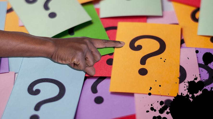 A hand points at different coloured question marks