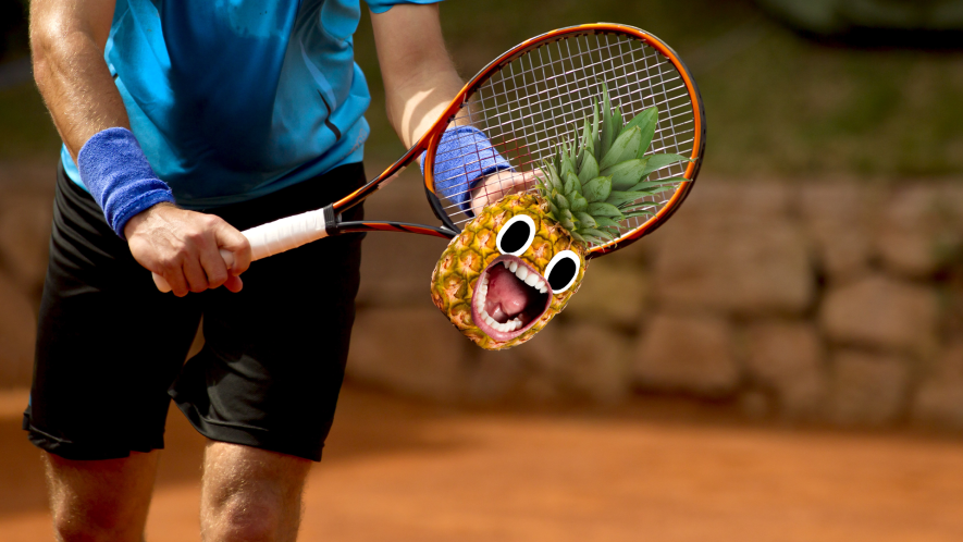 Man playing tennis with pineapple
