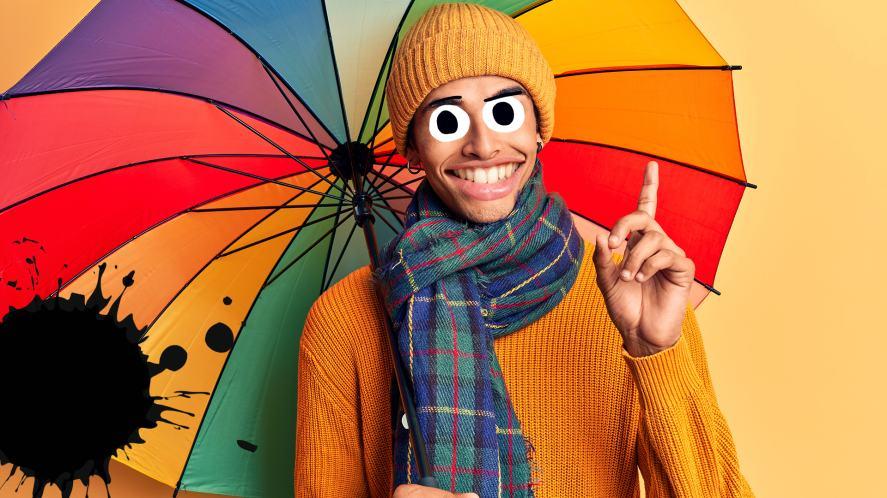 A man with a rainbow umbrella