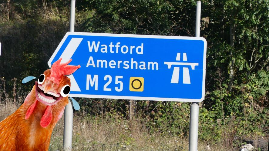 A road sign pointing to Watford