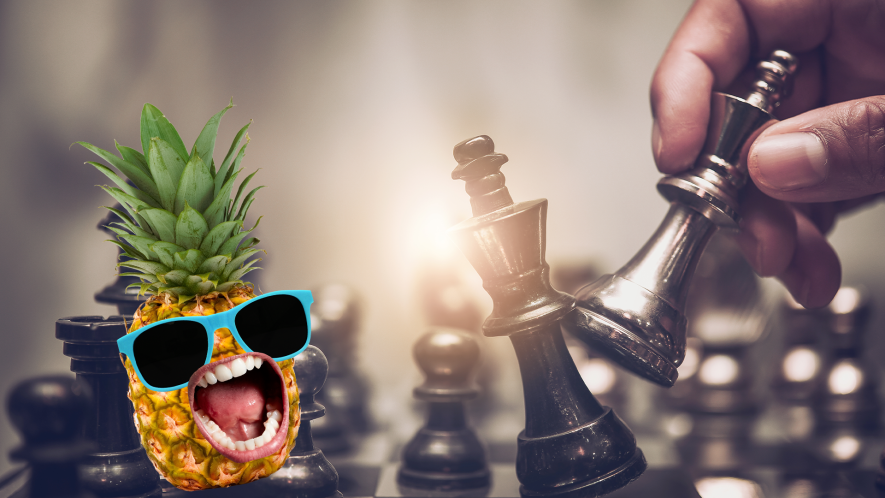 Chess pieces and pineapple