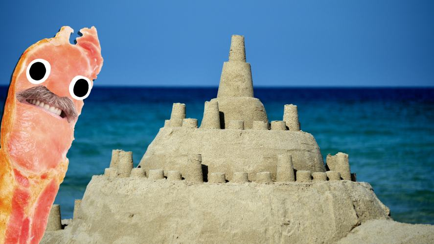 Bacon Dad looks at a sandcastle