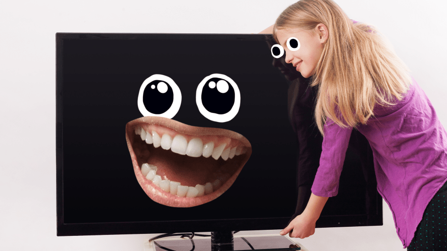Girl holding a TV