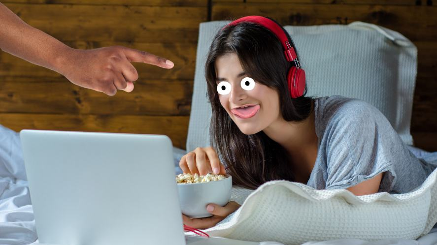 A woman watching TV on her laptop