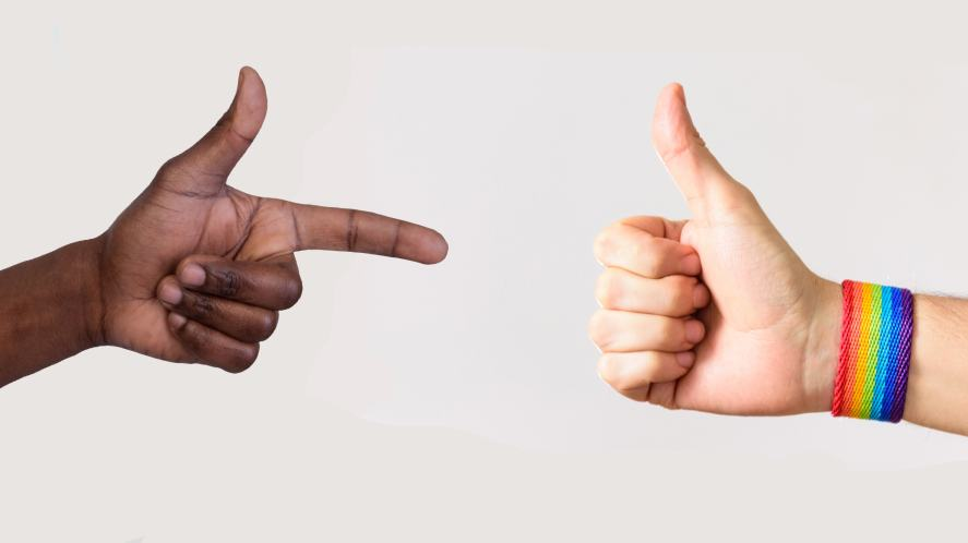 Two people give a thumbs up