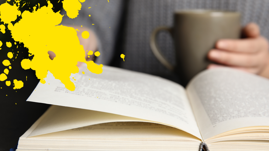 Person reading book with yellow splat