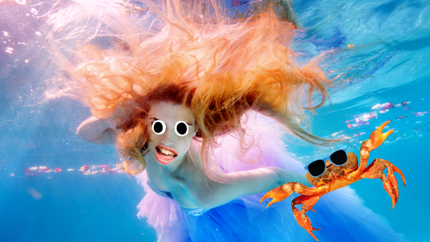 Mermaid swimming with crab