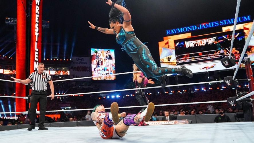 WWE wrestler doing a splash from the top rope