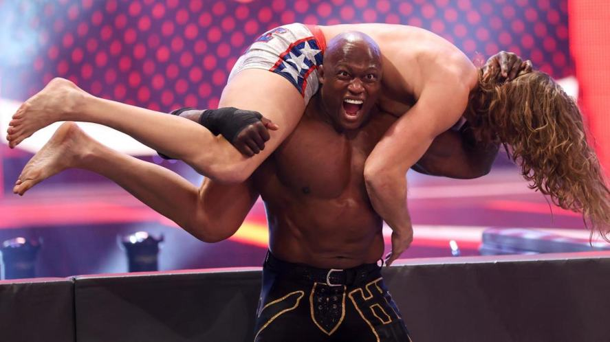 WWE wrestlers fighting outside the ring