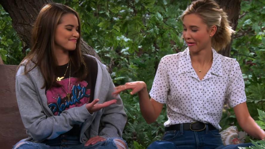 Alexa and Katie doing a cool handshake