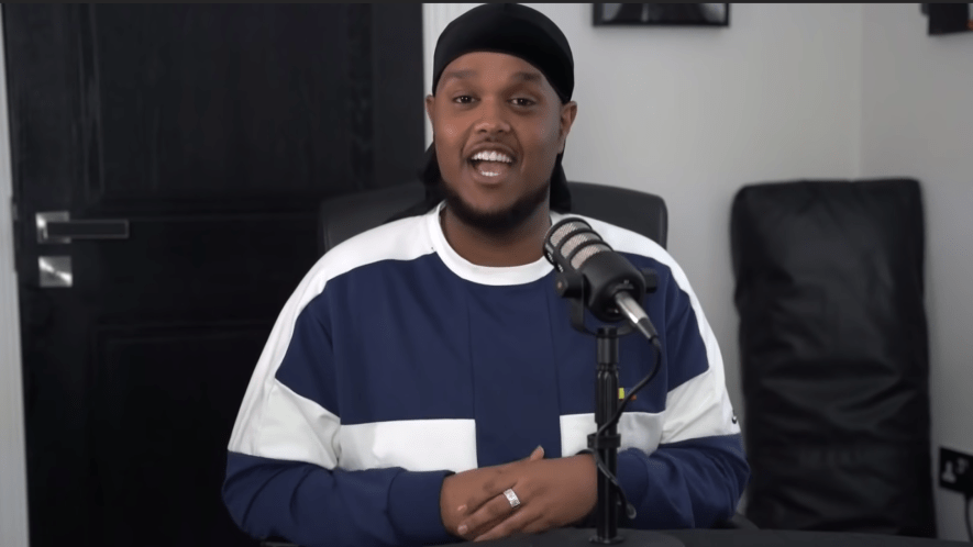 Chunkz sat at desk in front of microphone