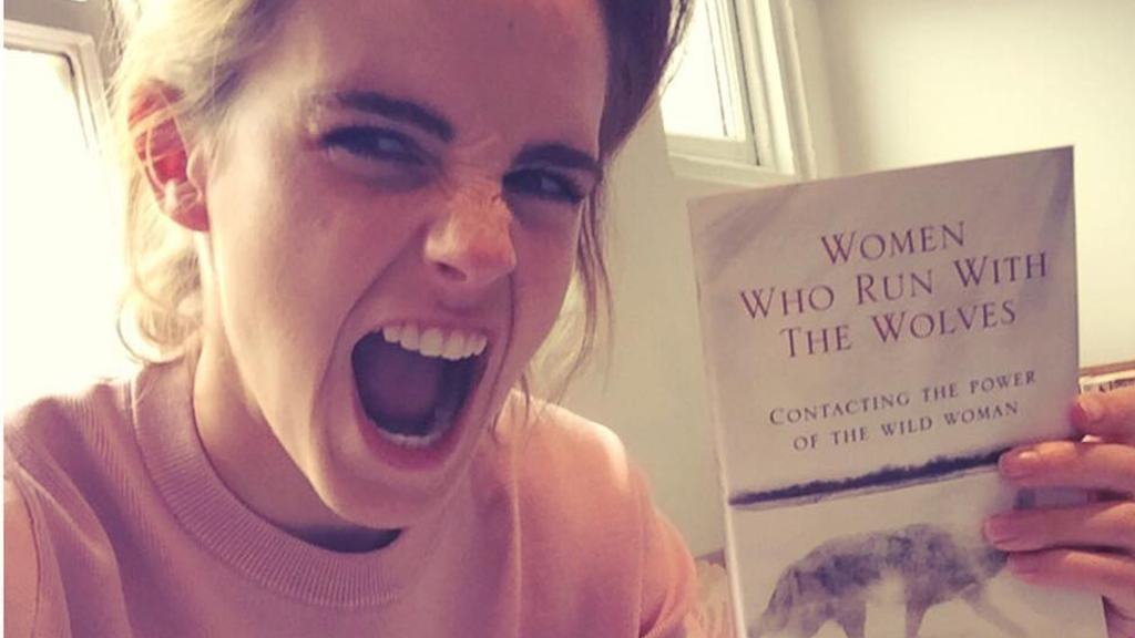 Emma Watson holding a book