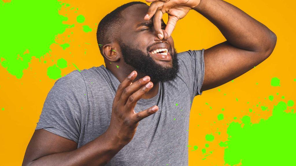 A man smelling a bad fart