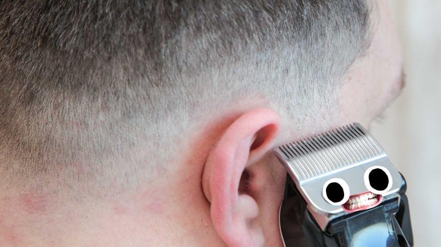 A man giving himself a haircut