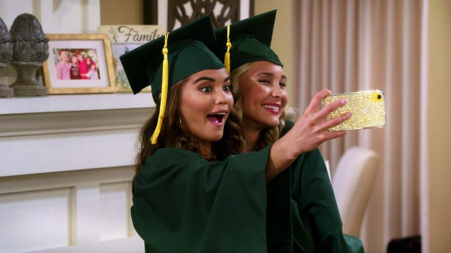 Alexa and Katie in university gowns