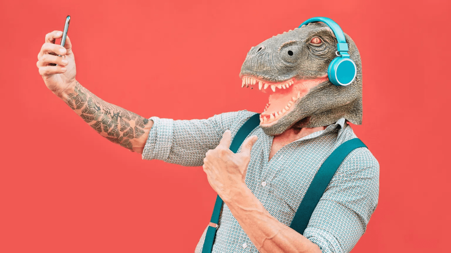 A person in a dinosaur mask