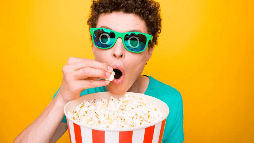A person snacking on popcorn