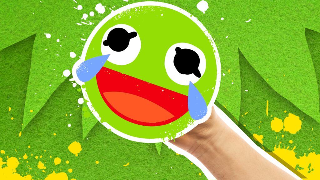A laughing green faced emoji