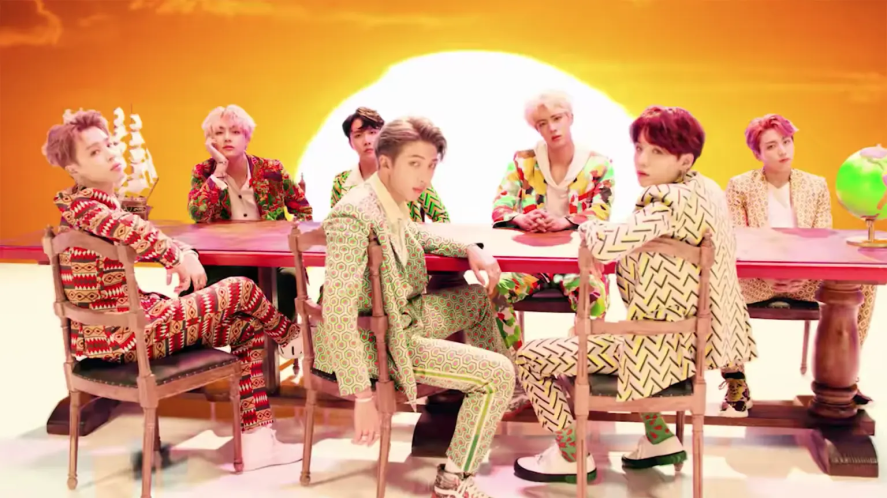BTS sitting at a big dining table