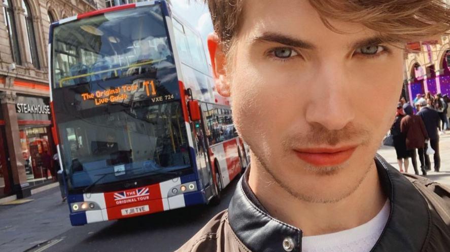 Joey Graceffa in front of a London bus