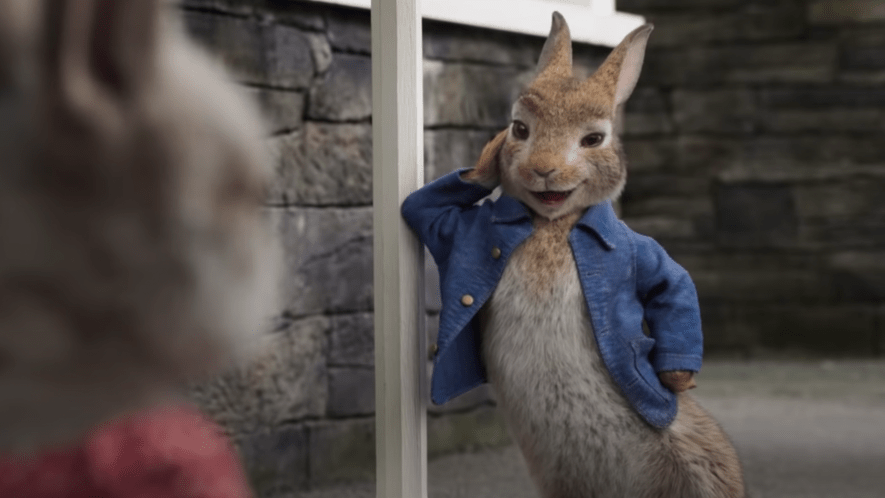 Peter Rabbit leaning on a post