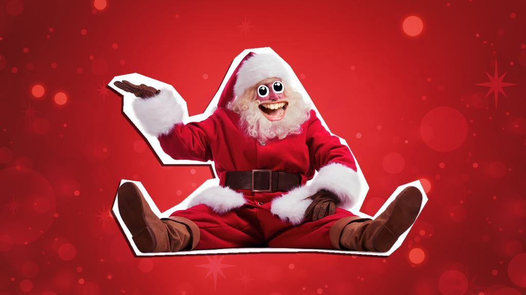 Laughing Father Christmas sitting down with his right hand in the air