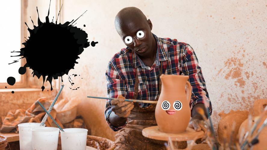 A man paints a vase