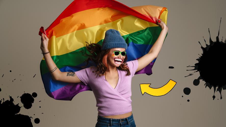 A happy woman with a rainbow flag