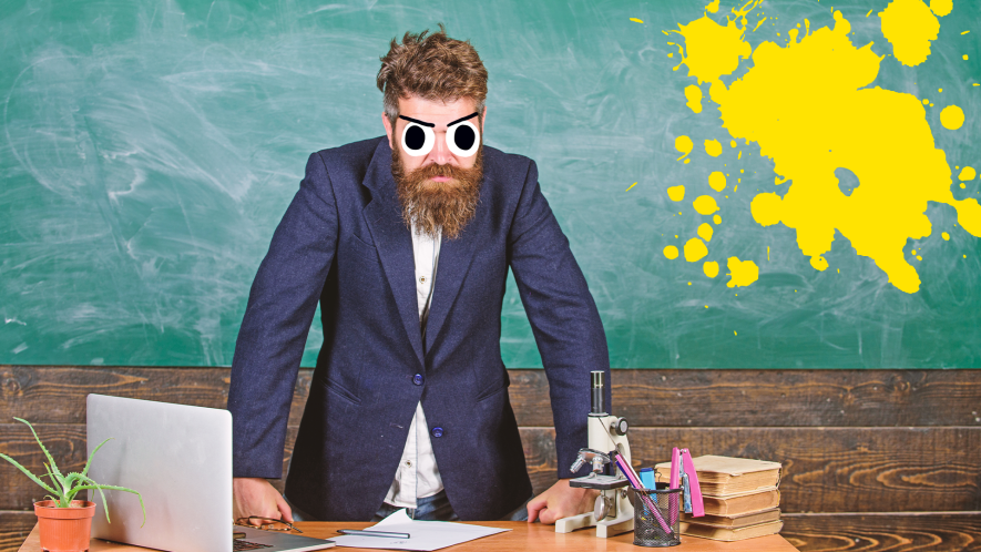 Angry looking teacher in front of blackboard with yellow splats