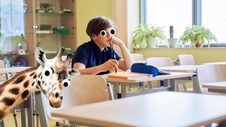 Boy alone in classroom with surprised giraffe