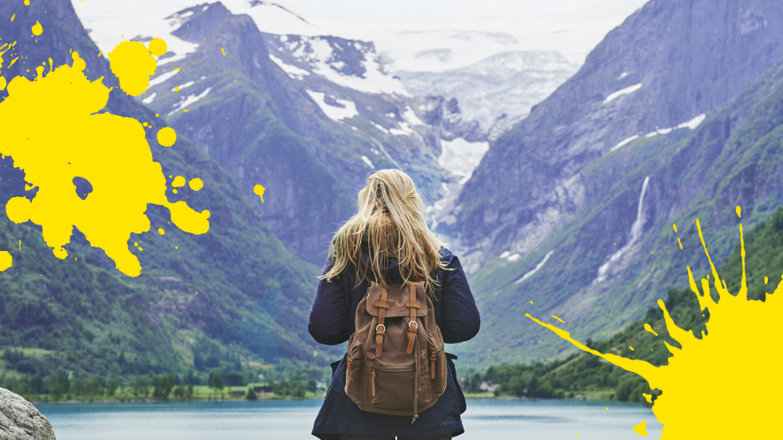 Woman in wilderness with yellow splats