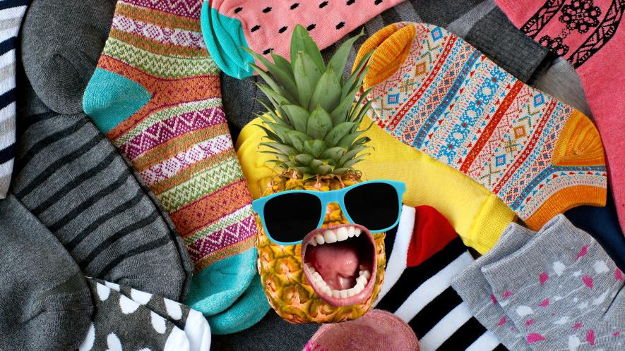 Screaming pineapple on socks background