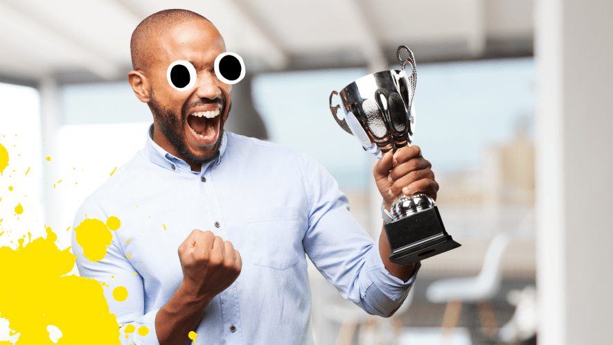 Man with trophy celebrating with yellow splat