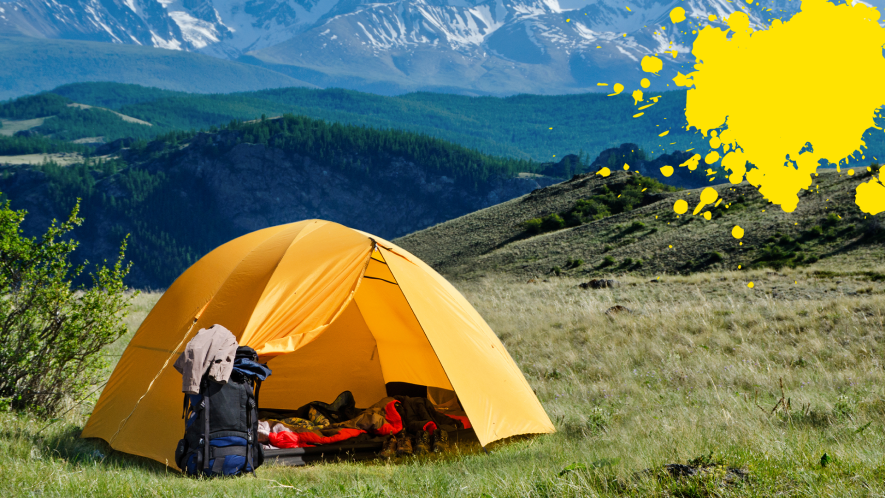 Tent on hillside with yellow splat